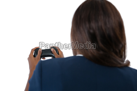 rear view of businesswoman playing video
