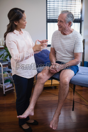 female therapist gesturing while talking with