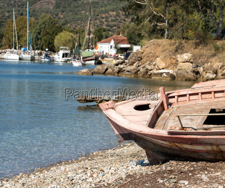 idyllic fishing village with old discarded