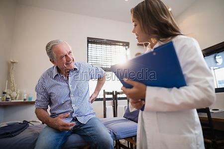 senior male patient showing back ache