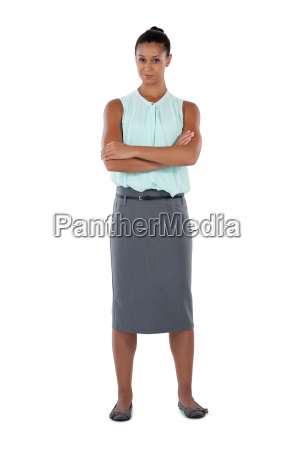 businesswoman standing with arms crossed against