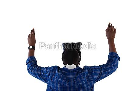 man gesturing while using virtual reality