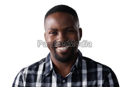 smiling man standing against white background