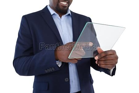 businessman using a glass digital tablet