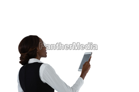 side view of woman using tablet