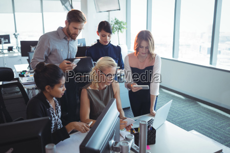 focused business colleagues working together while