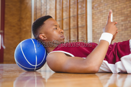 side view of male basketball player