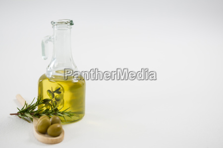 marinated olives with oil bottle and