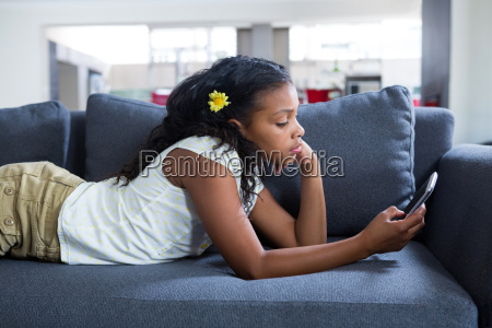 side view of girl using phone