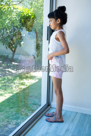 side view of girl looking through