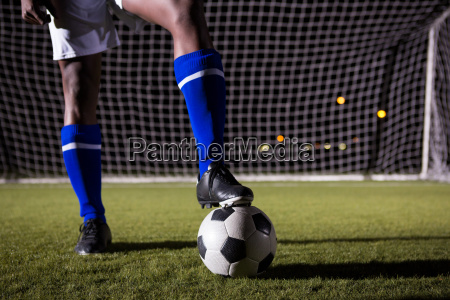 low section of male soccer player