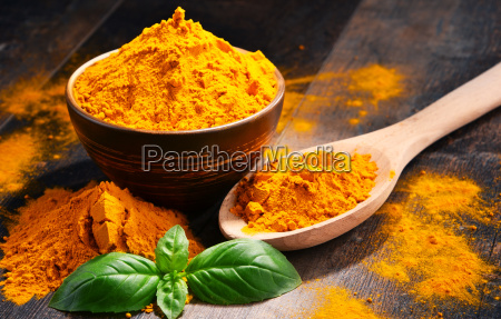 composition with bowl of turmeric powder