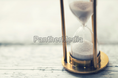 time is ticking hourglass on