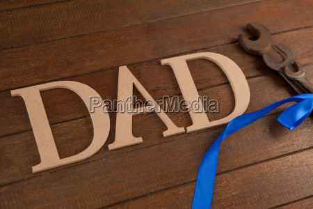 dad text by wrenches on table