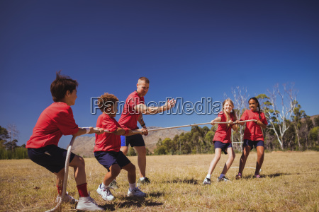 kids playing tug of war during