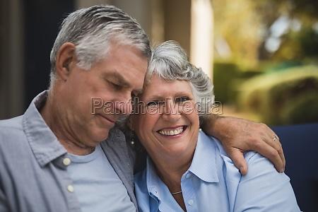 portrait of smiling senior woman embracing