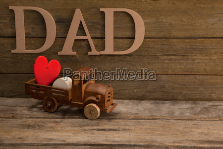 toy truck with red heart against