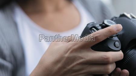 photographer using digital camera
