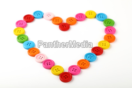heart shaped of colorful sewing buttons