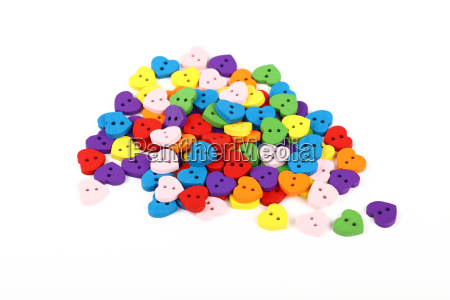 colorful heart shaped sewing buttons over