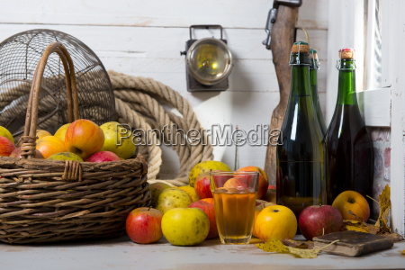 organic fresh apples with bottle of