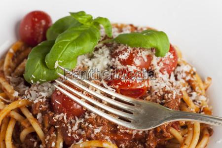 silver fork on spaghetti bolognese
