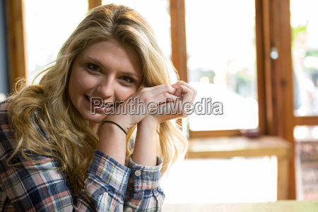 beautiful young woman smiling in coffee