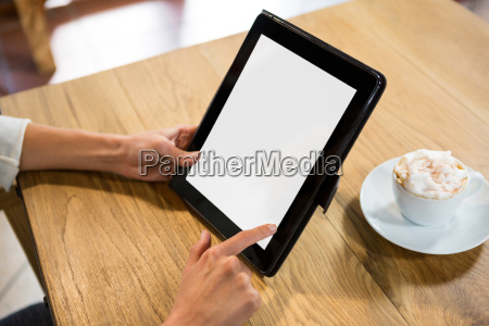 woman using digital tablet with blank