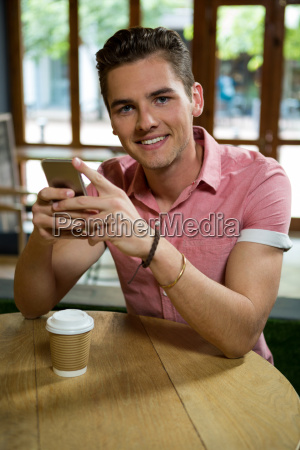handsome young man using mobile phone