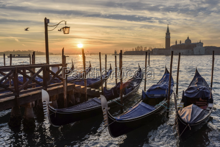 gondolas moored on a canal in