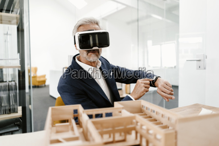 mature businessman with architectural model in