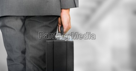 business person legs with brief case