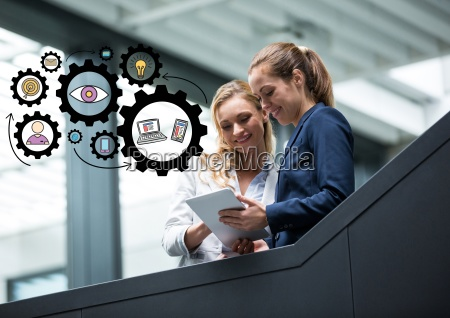two business women on stairs with