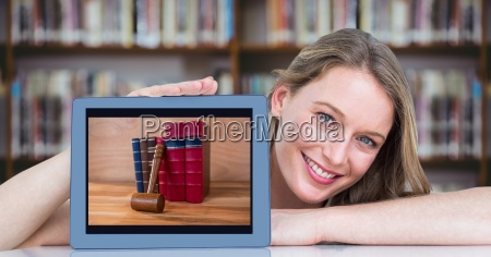 happy woman presenting tablet with pile