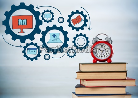 pile of books and clock with