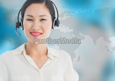 travel agent with headset against map