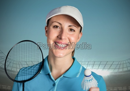 badminton player against blue sky and