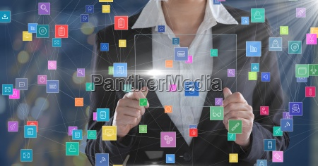 business woman holding futuristic device surrounded