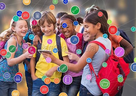 children with phone against blur background