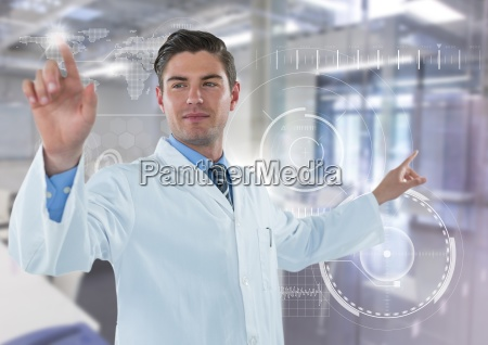 man in lab coat pointing with