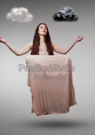 woman meditating in mid air and
