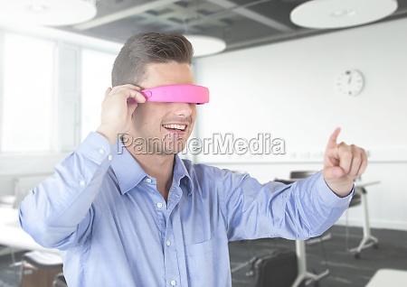 man using virtual reality glasses at