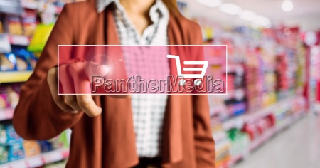 mid section of woman touching shopping