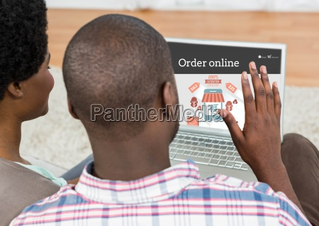 couple doing online shopping on laptop