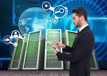 businessman using digital tablet against data