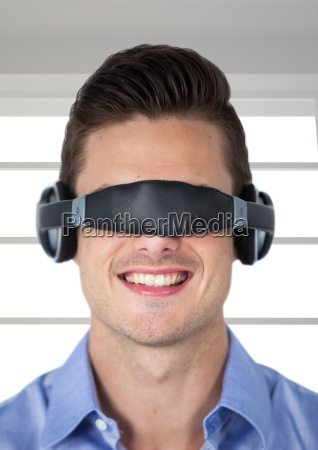 smiling man using virtual reality glasses