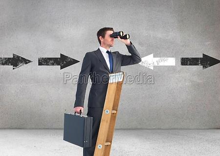 businessman looking through binoculars while standing
