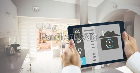 hands holding digital tablet with home