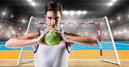 athlete playing handball against stadium in