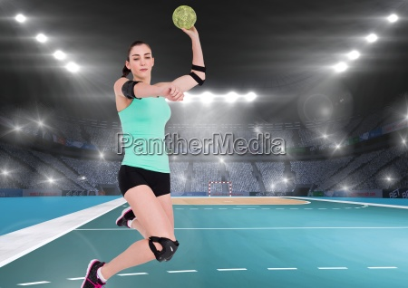 female handball player throwing ball at
